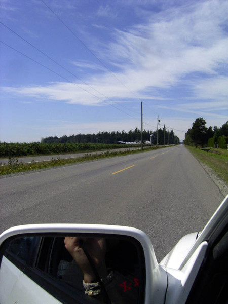 Yup... largest undefended boarder. I'm in Canada, the road across the grassy meridian is the US.